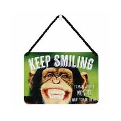 Tin plaque - keep smiling it makes people wonder what you are up to - chimpansee